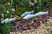 WOODEN FISH SCULPTURE IN DAVID AND MARIE CHASE'S Garden, Hampshire