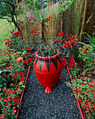 THE Red Garden with Black GLASS GRAVEL, Red AND Black Pot with OPHIOPOGON PLANISCAPUS NIGRESCENS, Red LILIES, DAHLIA 'BISHOP of LLANDAF' AND Achillea 'FANAL'