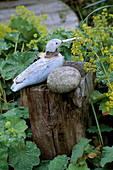 WOODEN SEAGULL On A Post SURROUNDED by ALCHEMILLA MOLLIS IN DAVID AND MARIE CHASE'S Garden, Hampshire