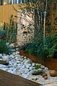 ROOF Garden with BAMBOO FENCING, White Boulders, BARLEYCORN GRAVEL, Red CEDAR DECKING AND Water Feature: DESIGN by ALISON WEAR ASSOCIATES