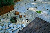 ROOF Garden with BAMBOO FENCING, White Boulders, Fossil Mint SLABS, WOODEN BALLS AND Red CEDAR DECKING: DESIGN by ALISON WEAR ASSOCIATES