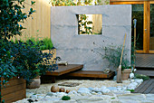 ROOF Garden: BAMBOO FENCE, White Boulders, Red CEDAR DECK AND SEATS, RENDERED WALL with WINDOW AND BESOM BROOM: DESIGN by ALISON WEAR ASSOCIATES