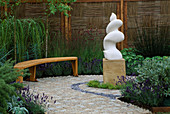 THE Garden of WORDS, HAMPTON Court 2003, Designer: LIZ ROBINSON: STONE WORD SCULPTURE, RECYCLED TIMBER BENCH, Granite SETTS AND COPPICED FENCE