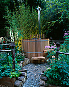 CHELSEA 2004: ST GEORGE'S ENCLOSURE / Designer PAUL HERRINGTON: Wood- FIRED CEDAR Hot TUB IN WOODLAND SETTING