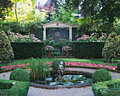 Amsterdam: PRIVATE Garden with Box HEDGING, SUMMERHOUSE, CLIPPED HOLLIES, BEDDING BEGONIA, Pool AND CUPID Water FOUNTAIN