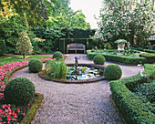 Amsterdam: PRIVATE Garden with Box HEDGING, CLIPPED HOLLIES, BEDDING BEGONIAS, Pool AND CUPID Water FOUNTAIN, STONE Urn AND WOODEN BENCH