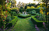 HALL Farm, Lincolnshire: Garden with Formal BOXED EDGED BEDS PLANTED with PERENNIALS
