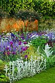 CHELSEA FLOWER Show 2006: DAILY TELEGRAPH Garden DESIGNED by Tom STUART-Smith: CORTEN STEEL WALL, ALLIUM 'Purple Sensation', STACHYS BYZANTINA, Iris, ORLAYA GRANDIFLORA, STIPA, Nepeta