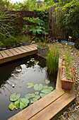 KATHY TAYLORS Garden, London: BACK Garden with POND / Pool EDGED with DECKING