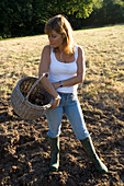 Garden Designer Clare MATTHEWS IN HER Devon with A BASKET of POTATOES