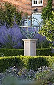 DAVID HARBER SUNDIALS: Bronze ARMILLARY SPHERE SUNDIAL On PLINTH IN Formal Garden with PEROVSKIA Blue SPIRE