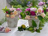 Rustikale Töpfe als Kerzenhalter , dekoriert mit Rosa (Rosen - Blüten)