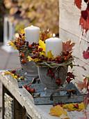 Herbstgestecke mit Kerzen