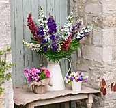 THE Garden AND PLANT COMPANY, Hatherop Castle, Cirencester, Gloucestershire: JUG with LUPINS, HESIAN Pot of Double COSMOS, PALE of Mixed Sweet PEAS
