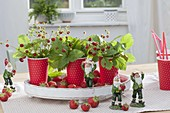 Strawberry table decoration in red and white cups