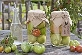Green tomatoes, sweet and sour pickled in glasses