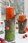 Natuerliche Kerzendeko am Fenster