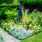 Blue TRIPOD SURROUNDED by ANTHEMIS TINCTORIA 'E C BUXTON' AND Artemisia LUDOVICIANA 'VALERIE FINNIS'. ARROW Cottage, Herefordshire