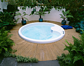 Spa Pool SURROUNDED by Palms IN POTS AND DECKING. HAMPTON Court 2000, Designer BOARDMAN GELLY & CO