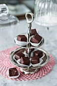 Raspberry-flavoured vegan nougat chocolate cubes on an étagère