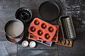 Metal and silicone baking trays and tins
