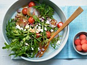 A fruity arugula salad with watermelon, fresh cheese and radishes