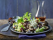 Leaf salad with grilled mushrooms, hazelnuts and elderberry juice vinaigrette
