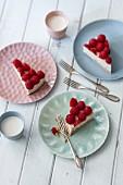 Slices of vegan cheesecake with cashew cream and raspberries
