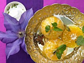 Poached clementines with cardamom, star anise and rose water