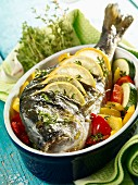 Whole sea bream on a bed of vegetables