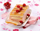 Charlotte with banana and raspberry cream