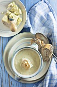 Celery and stilton soup in a bowl on a blue wooden table