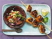 Tamarind chicken skewers with an avocado and tomato salad