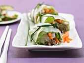 Thai spring rolls with pork chops, salad and glass noodles
