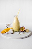 A coconut milk, mango, banana and passion fruit smoothie