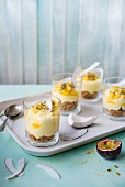 Individual mango and coconut cheesecakes wirh passion fruit