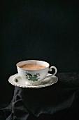 Vintage porcelain cup of tea with milk