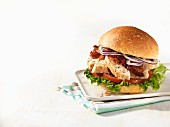 Person Holding a Fried Chicken Sandwich with Lettuce on a Bun