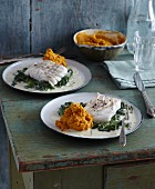 Cod with carrot hummus and baby leaf spinach