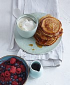Fluffy kefir pancakes with fresh berries and ricotta cream