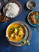 Fish curry with mango, tomatoes and coconut milk (Asia)