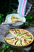 Asparagus and ham tart on a garden chair
