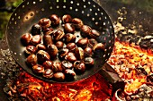 Chestnuts being roasted on an open fire