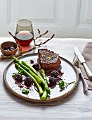 Filet steaks with green asparagus and chilli and blackberry sauce (low carb)