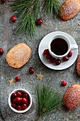 Cranberry and orange madeleines with espresso, fir tree branches, cranberries and stars