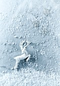 White and silver Christmas decorations on a marble background