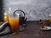 Hot orange and ginger tea with spices