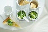 Pita corners with pea dip and crispy sprouts
