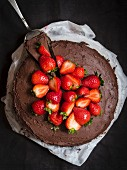 Paleo (floverless and gluten free) chocolate cake with strawberries