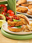Spicy pinto bean burger with salsa and tortilla chips